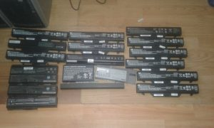 Laptop batteries ready to have 18650 cells harvested